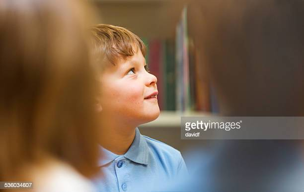 Young School Boy Listening in the Classroom
