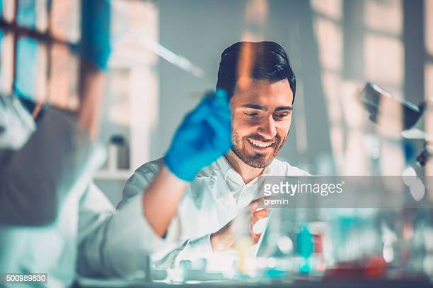 Young scientists in laboratory, research, technology