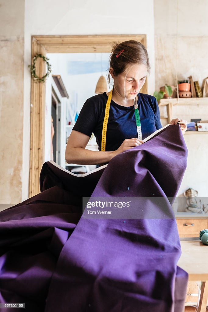 Young Seamstress Holding Fabric