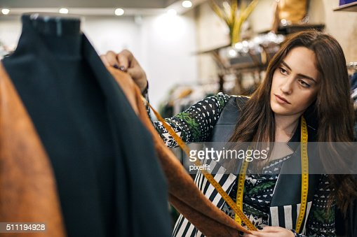 Young seamstress in a fashion store