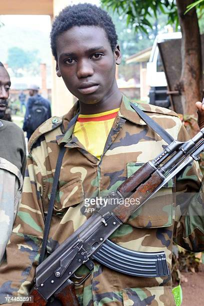 A young Seleka fighter poses on July 25 2013 at the Bangui firefighters barracks turned into a Seleka base The transition in Central African Republic...