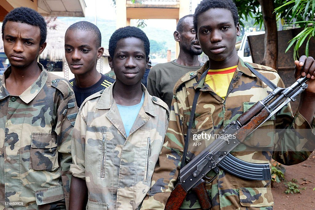Young Seleka fighters pose on July 25, 2013 at the Bangui firefighters barracks, turned into a Seleka base. The transition in Central African Republic, overrun by rebels in March, must not exceed 18 months, the African Union warned last week. 'The transition in CAR is not meant to last more than 18 months' until free and fair elections are held, the AU's peace and security chief Ramtane Lamamra said. That would mean the mineral-rich nation would have to hold polls by September 2014 at the latest. A rebel coalition known as Seleka seized power on March 24, forcing President Francois Bozize to flee.