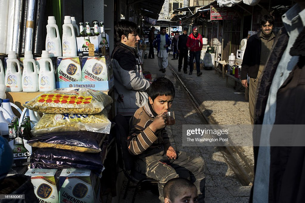A young seller drinks tea near his stall in Bush Market. If a case of soap is pilfered from a U.S. military base here or pinched from a NATO shipping container, it will probably, sooner or later, end up for sale in the Bush Market, a sort of thieves' outlet mall in central Kabul. Named after the former U.S. president who launched the war in Afghanistan, the bazaar has flourished for more than eight years, thanks to the long presence of foreign troops that provided war booty aplenty. But in the Obama era, with its steady withdrawal of U.S. forces, the good times are ending.