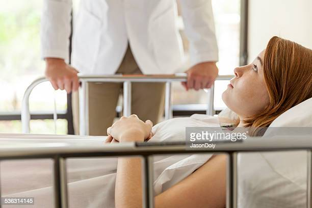 Young Serious Teenager in a Hospital Bed