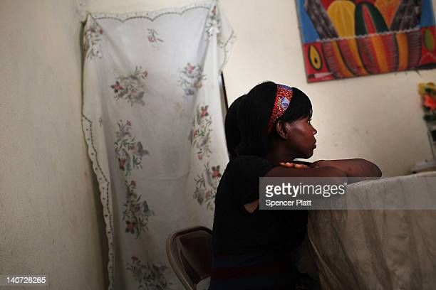 A young sexual assault victim sits in a home with her family after they were relocated from a camp with the help of the United Nations High...