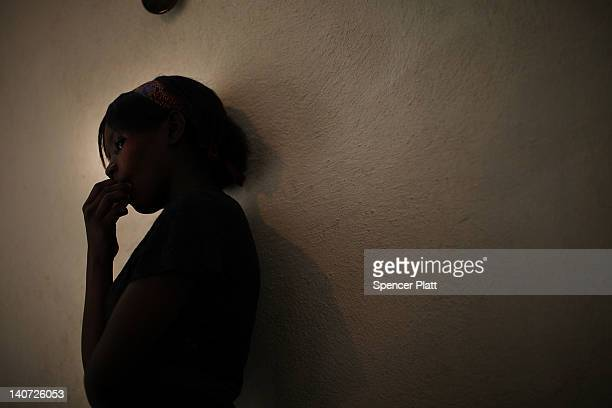 A young sexual assault victim stands in a home with her family after they were relocated from a camp with the help of the United Nations High...