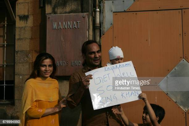 A young Shahrukh Khan fan prays for his favorite hero to get well soon after his Shoulder Surgery at his bungalow Mannat in Bandra