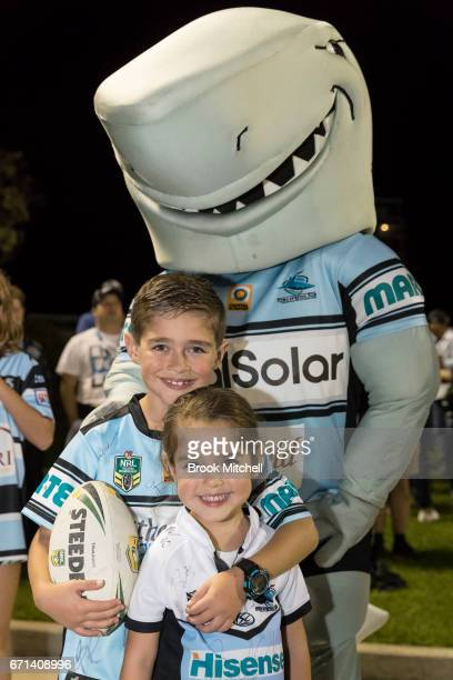 Young Sharks fans arrive for the round eight NRL match between the Cronulla Sharks and the Gold Coast Titans at Southern Cross Group Stadium on April...