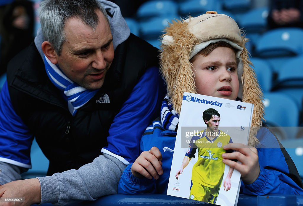 A young Sheffield Wednesday fan looks on during the FA Cup with Budweiser Third Round match between Sheffield Wednesday and Milton Keynes Dons at Hillsborough Stadium on January 5, 2013 in Sheffield, England.