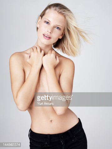 Young Shirtless Woman With Arms Covering Breasts Studio