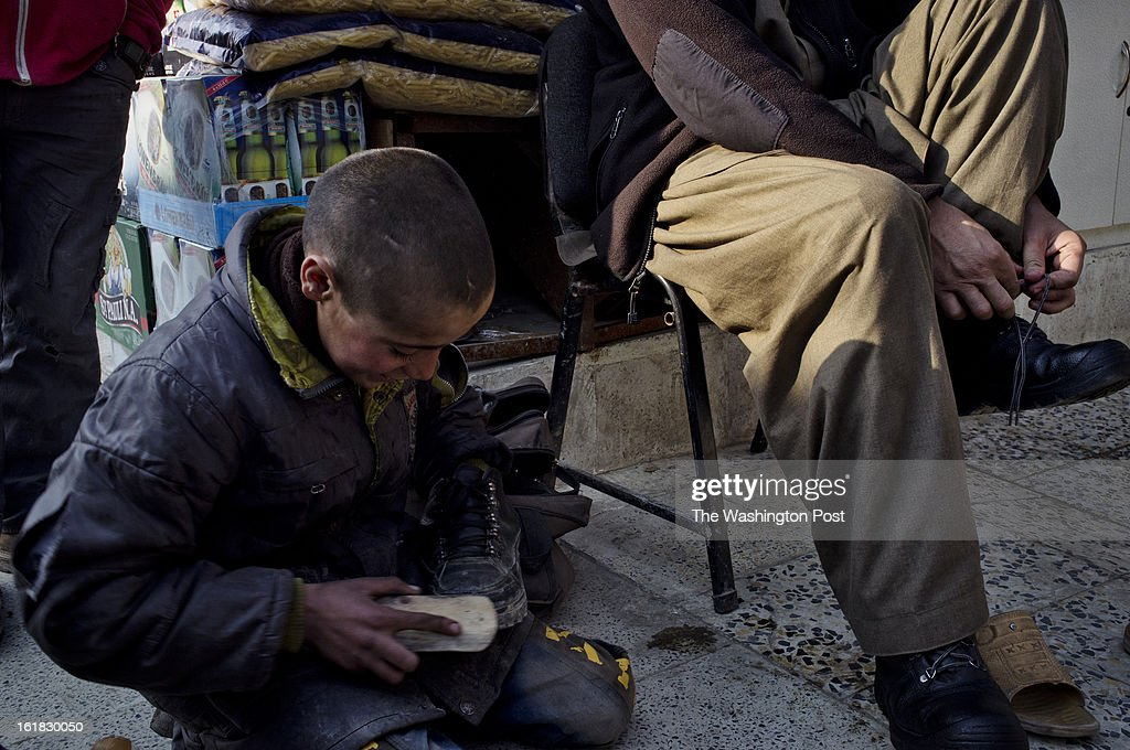 A young shoe polisher works near a stall in Bush Market. If a case of soap is pilfered from a U.S. military base here or pinched from a NATO shipping container, it will probably, sooner or later, end up for sale in the Bush Market, a sort of thieves' outlet mall in central Kabul. Named after the former U.S. president who launched the war in Afghanistan, the bazaar has flourished for more than eight years, thanks to the long presence of foreign troops that provided war booty aplenty. But in the Obama era, with its steady withdrawal of U.S. forces, the good times are ending.