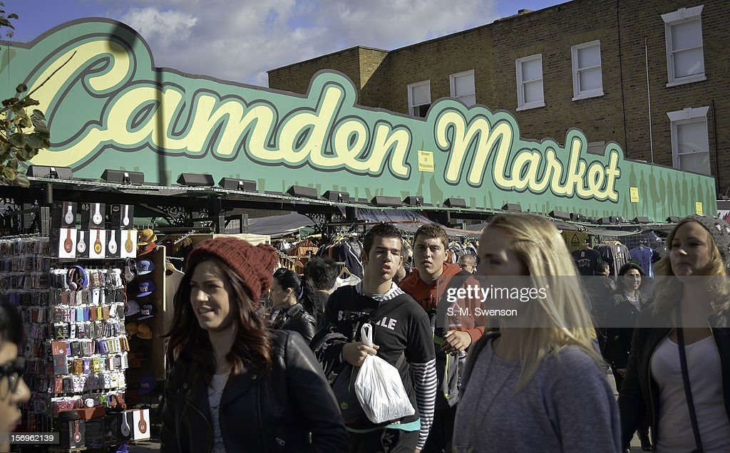 Young shoppers hit the world famous Camden Market on a sunny Saturday afternoon in September. Camden, North London, England, September 2012