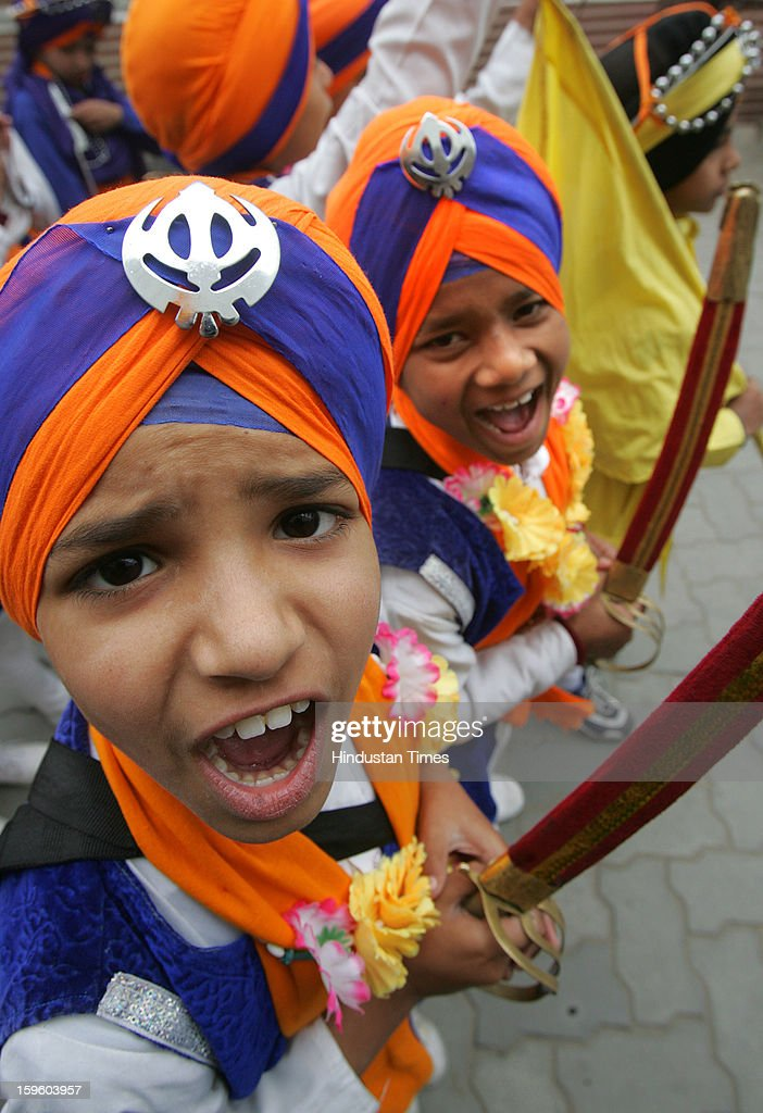 Young Sikh children dressed as Panj Pyare raising slogans as taking part in the religious procession on the eve of Birth Anniversary of 10th Sikh Guru Gobind Singh Ji, on January 17, 2013 in Amritsar, India. Guru Gobind Singh Ji was 10th and the last of the living Sikh Gurus who founded the Sikh Khalsa in 1699.