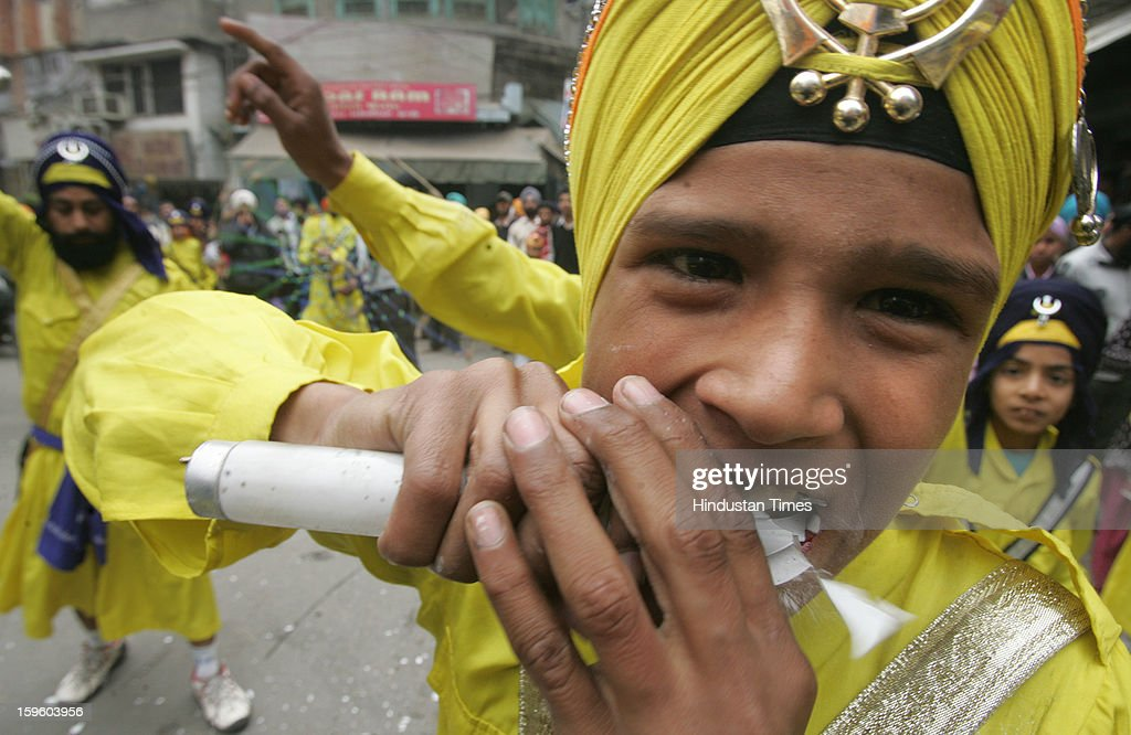 A young Sikh warrior eating tube-light while taking part in a religious procession on the eve of Birth Anniversary of 10th Sikh Guru Gobind Singh Ji, on January 17, 2013 in Amritsar, India. Guru Gobind Singh Ji was 10th and the last of the living Sikh Gurus who founded the Sikh Khalsa in 1699.