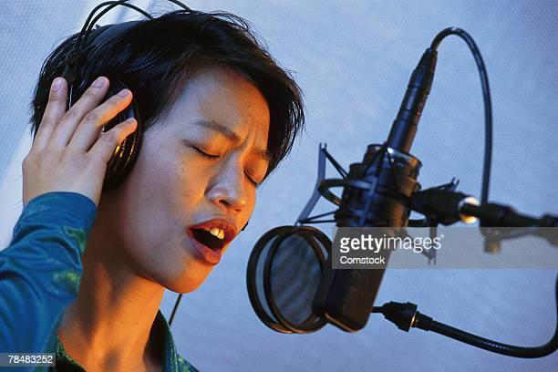 Young singer recording in studio