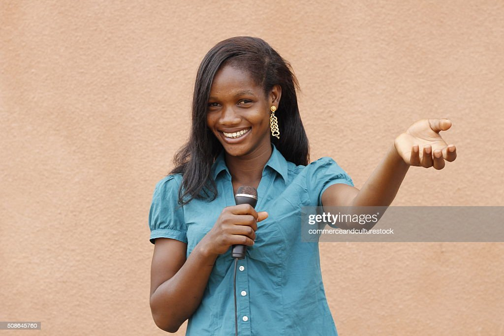 A young singer with a microphone : Stock Photo