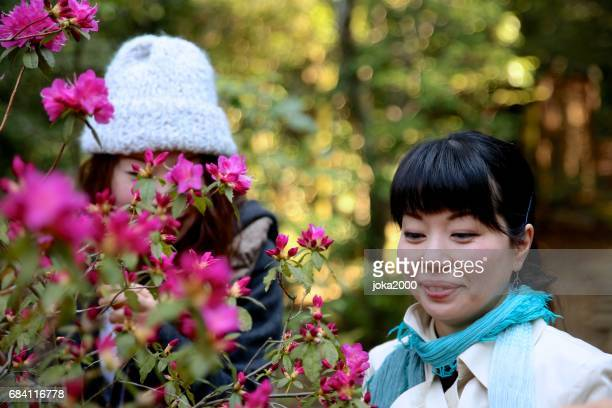 Young sisters enjoying flower picture