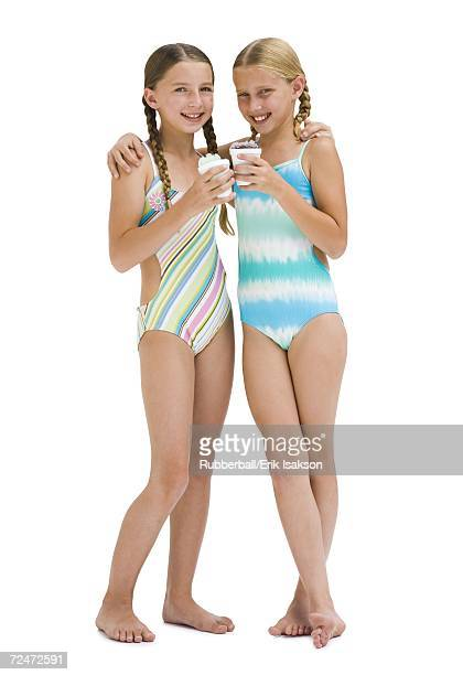 Young sisters in swimsuits on vacation