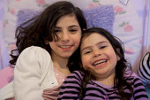 Young sisters laughing and smiling