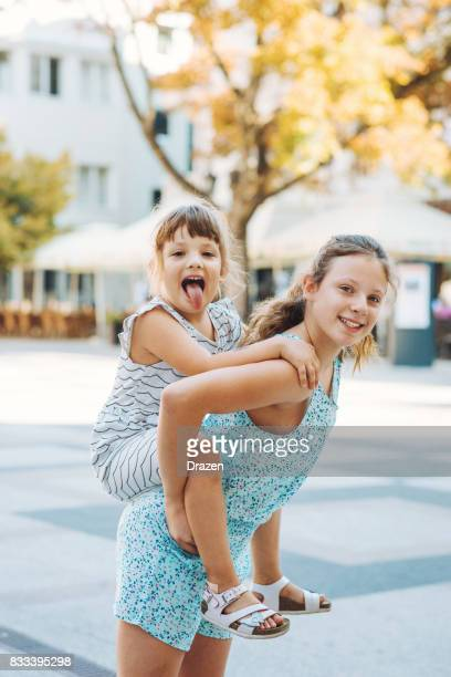 Young sisters playing together
