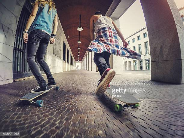 Young skaters riding longboard skateboards