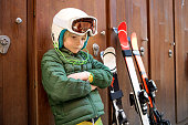 Young ski racer focusing before practice.