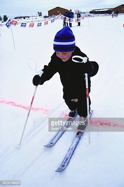 Young Skier Crossing Finish Line