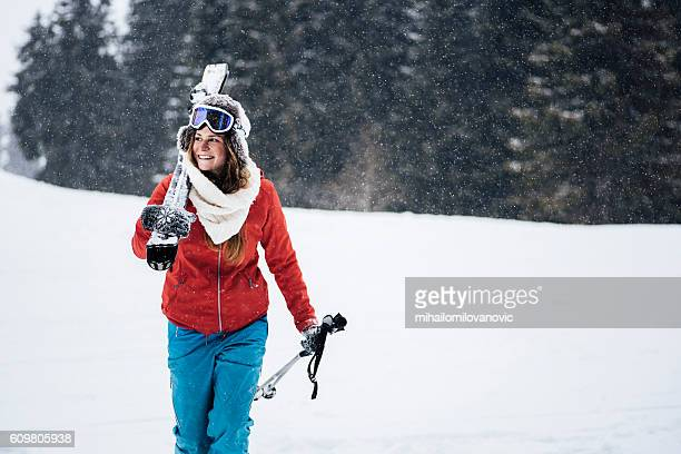 Young skier enjoying the snowy scenery