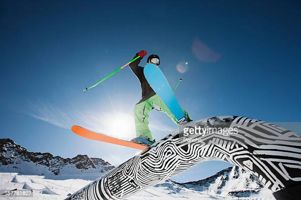 young skier sliding along a rail