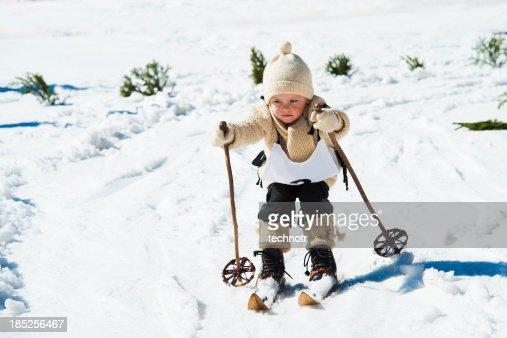Young skier using retro ski equipment