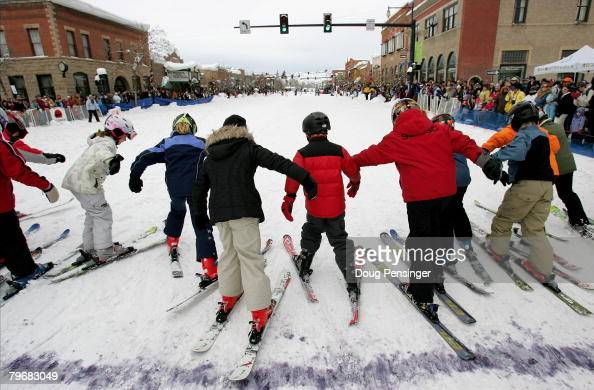 Young skiers leave the starting line for the 50 yard dash down Lincoln Avenue during the Street Events at the 95th Annual Steamboat Springs Winter...