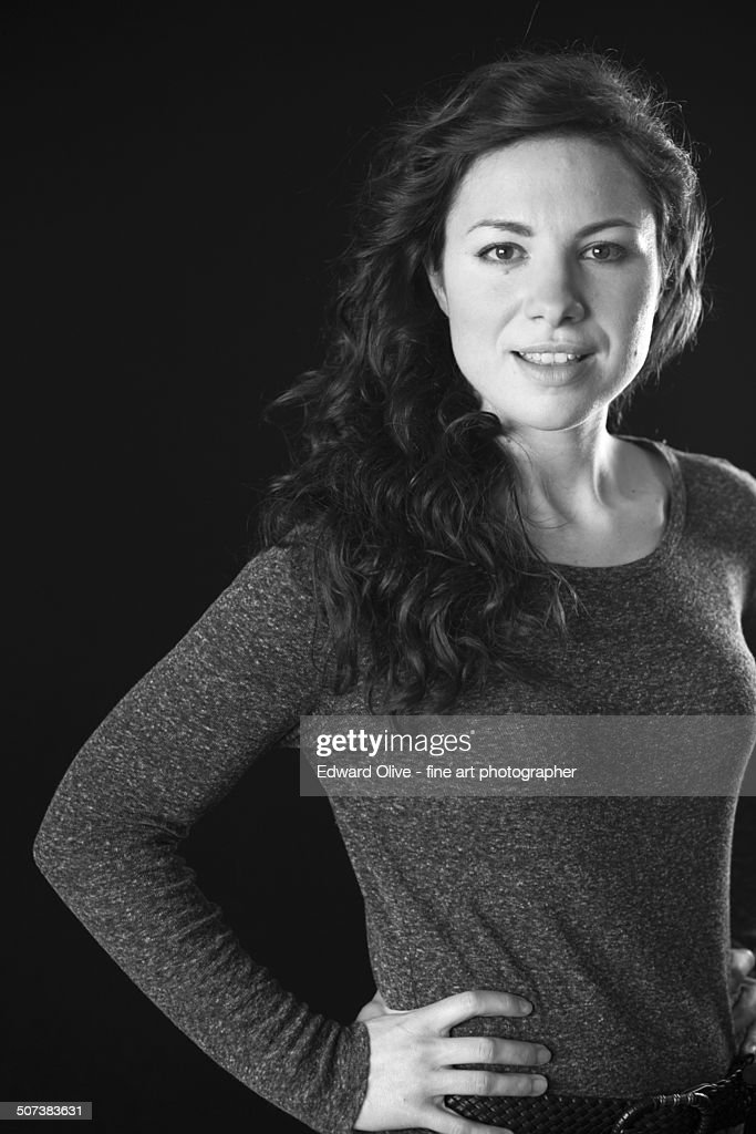 Young slim woman in tight sweater looking
