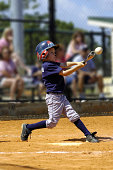 A ten-year-old hits a home run in a youth league game