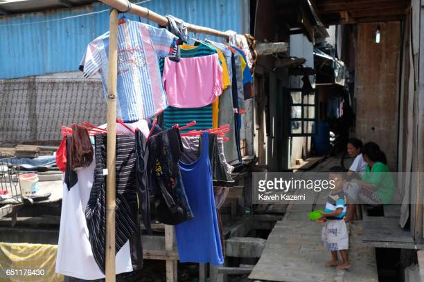 A young slum dweller kid seen in a shanty town on November 27 2016 in Jakarta Indonesia