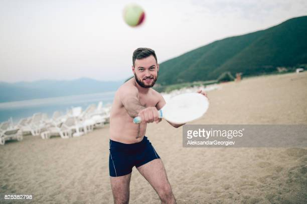 Young Smiling Boy Play Beach Tennis Paddle Ball