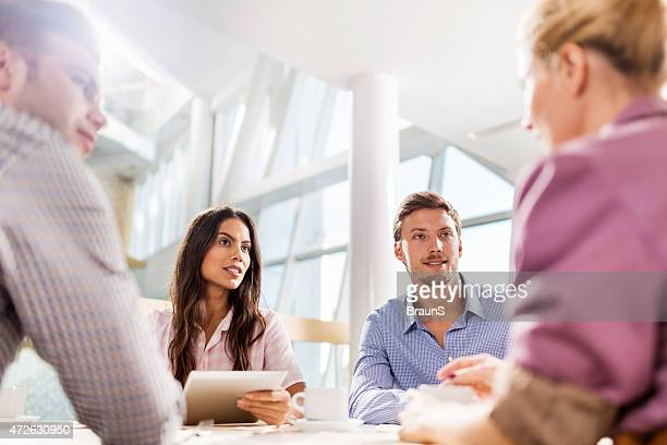 Young smiling business people talking on a meeting.