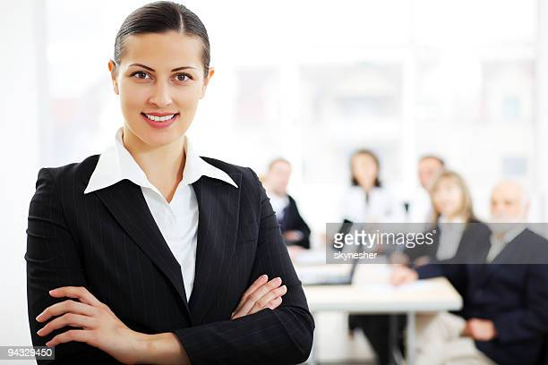 Young smiling business woman in a office environment.