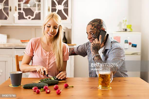 Young smiling couple enjoying their time in the kitchen.