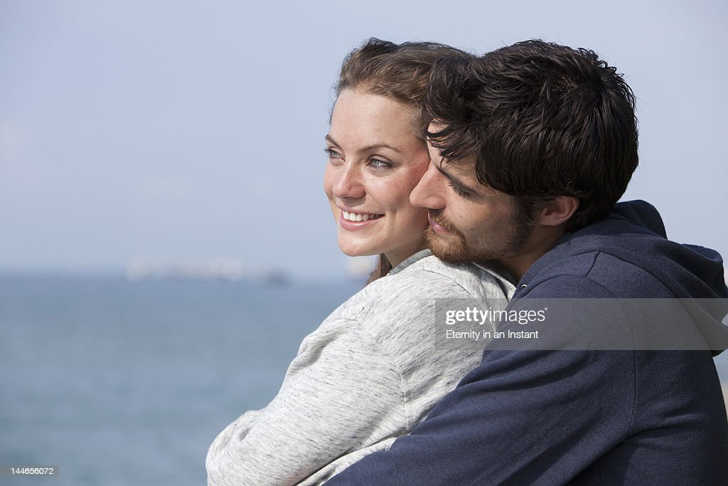 Young smiling couple outdoors : Stock Photo