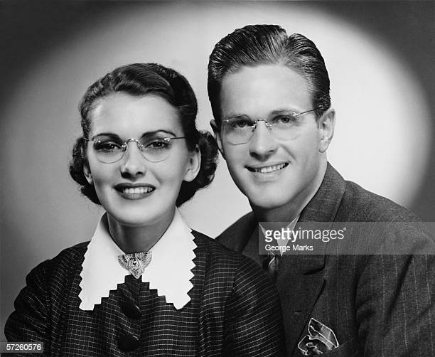 Young smiling couple, (B&W), portrait