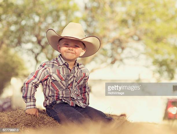 Young Smiling Cowboy in Western Wear on Ranch