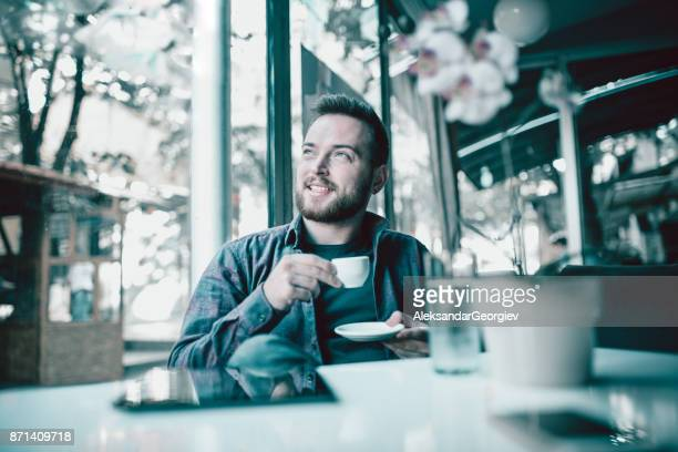 Young Smiling Man at Home with First Coffee in the Morning