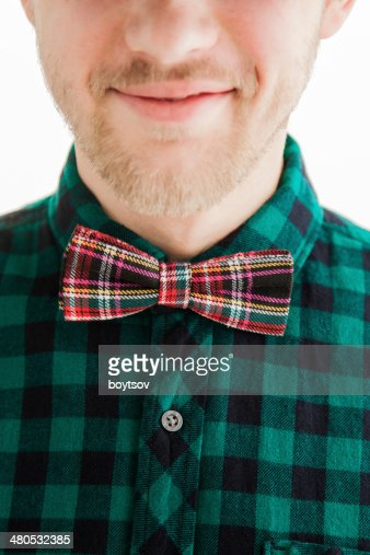 Young smiling man in bowtie : Stock Photo