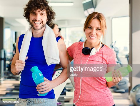 Young Smiling People in a gym.