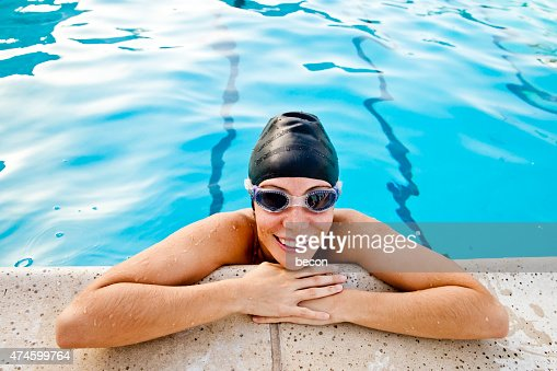 Young Smiling Woman at Edge of Pool