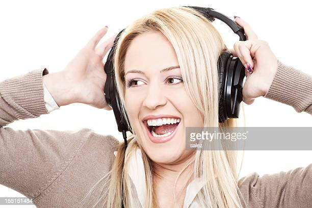Young smiling woman enjoying music