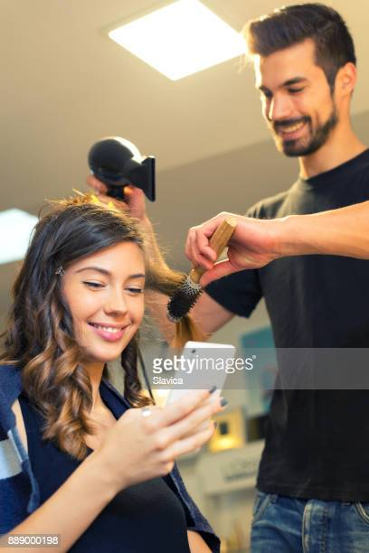 Young smiling woman in professional hair salon