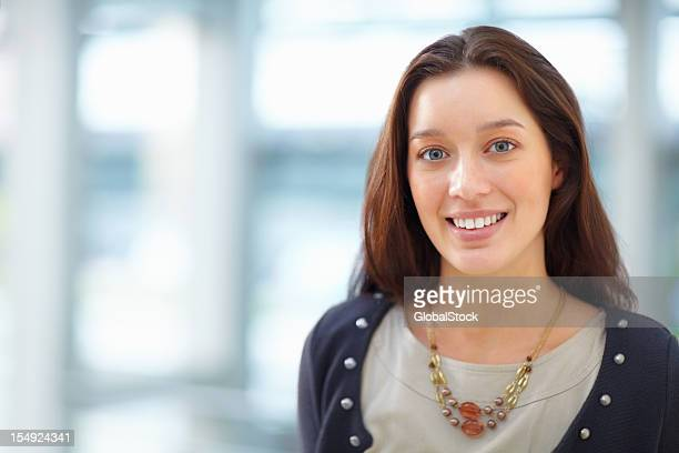 Young smiling woman portrait with blur background