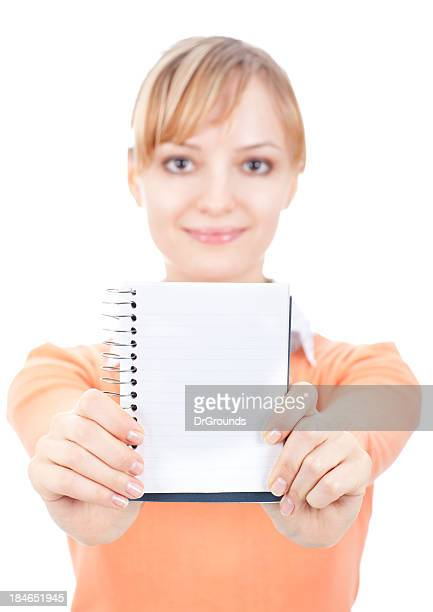 Young smiling woman showing empty notepad
