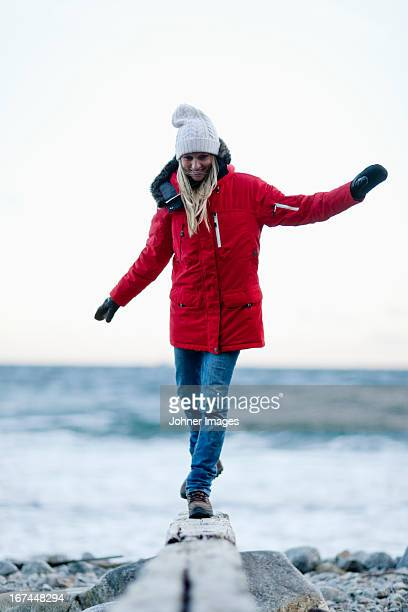 Young smiling woman walking on beach